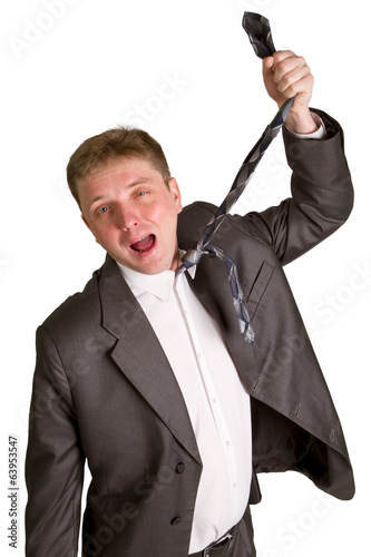 man pulling necktie out to choke himself while making facial exp