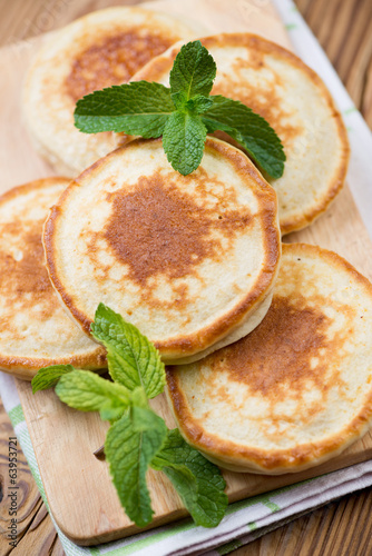Freshly made pancakes, vertical shot, close-up