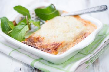 Baking dish with freshly made lasagna, horizontal shot