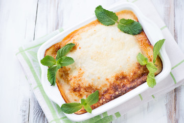 Vegetable lasagna with mint leaves, high angle view