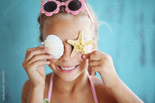 Child holding seashell