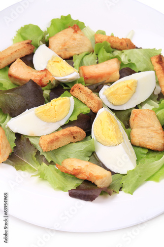 Caesar salad with eggs.