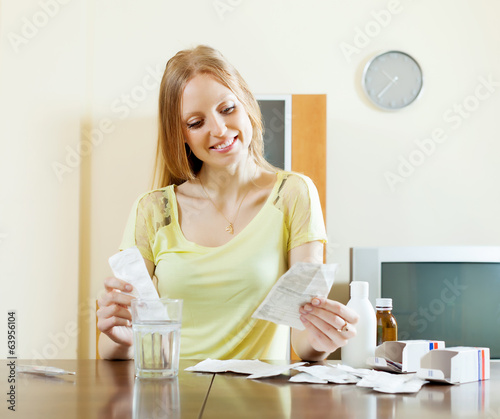 Positive young woman with medications