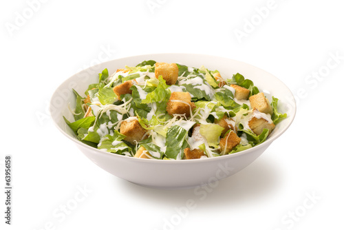 Aluminium Salade Caesar salad in a white plate