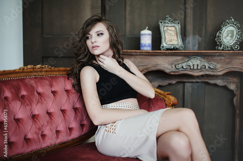young hot woman at home in pink sofa
