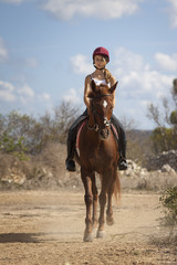 Teenage rider on horse