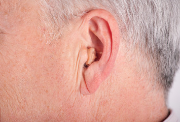 Senior wearing CIC hearing aid
