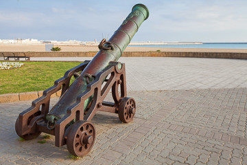Ancient cannon stands on the beach in Tangier, Morocco