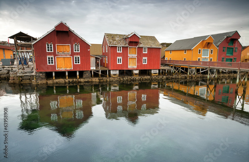 Red and yellow wooden houses in Norwegian fishing village. Rorvi