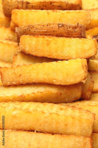 French fries for a fast food snack on a white background.