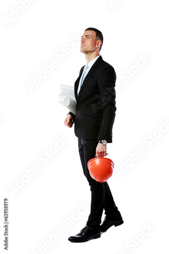 Portrait of a businessman holding helmet and drawings