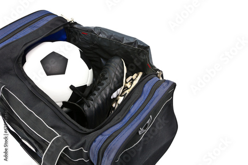 football and soccer boots in sport bag