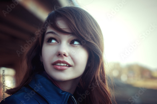 Pretty young smile woman outdoor bright portrait