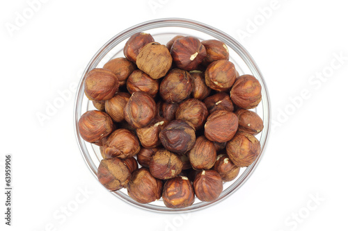 roasted hazelnut kernels on a white background