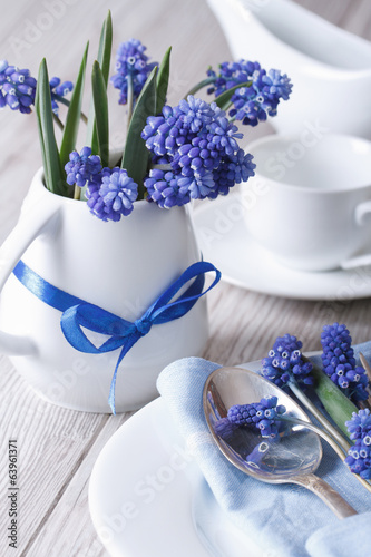 Elegant table setting with beautiful blue flowers muscari