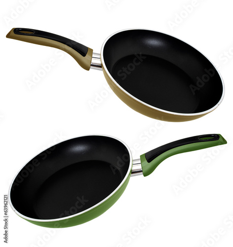 Frying pans, green and brown, beige isolated over white backgrou