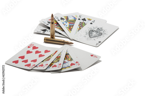 Royal flush and two cartridges isolated on white background