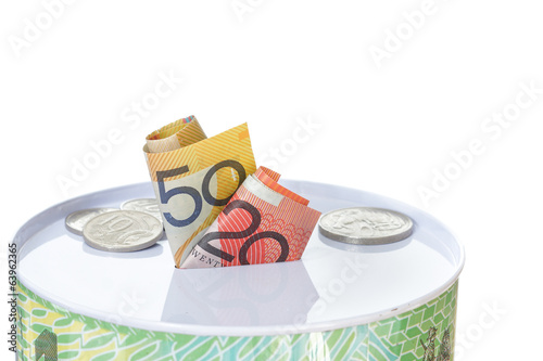 Australian notes and coins on a money tin
