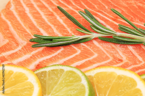 Closeup of salmon steak with rosemary.
