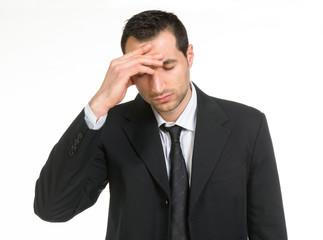 Uomo d'affari con mal di testa