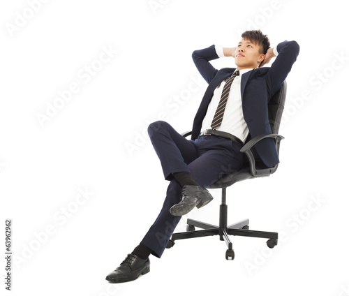 young businessman sitting on a chair and thinking