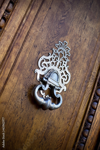 Old bronze door knocker of a French mansion
