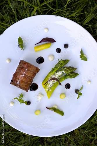 Piece of lamb, asparagus, parmesan cheese and sauces