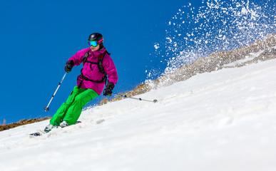 Man skier on a sky background