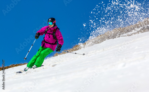 Man skier on a sky background