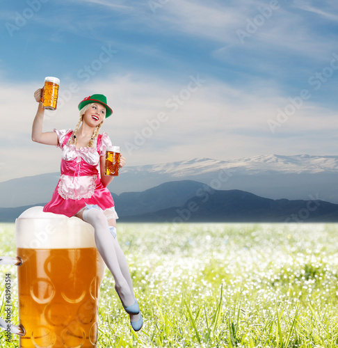 Tiroler or oktoberfest woman with beer