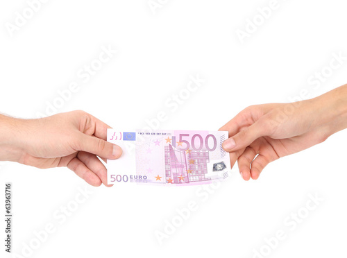 Two hands and 500 euro banknote.