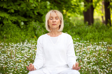 senior woman relaxation practising yoga