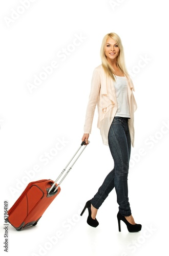 Blond woman with suitcase