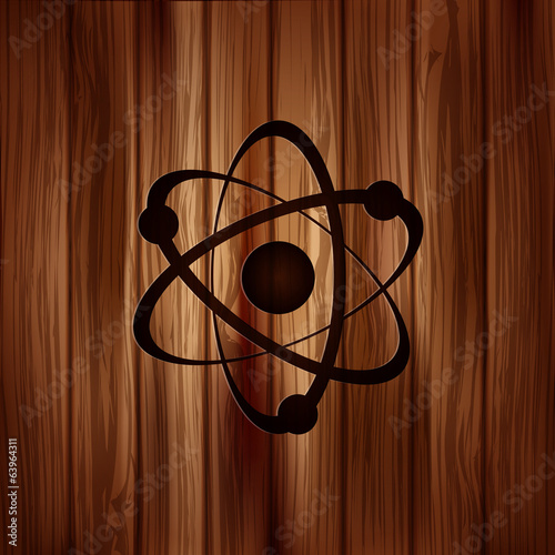 Molecule, atom icon.Wooden background