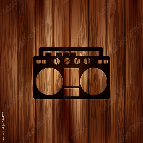 Retro tape recorder.Wooden background