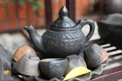 Ancient clay teapot and teacups