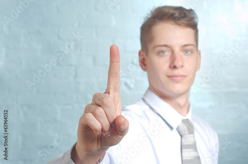 Businessman pushing imaginary button