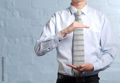 Businessman holding imaginary idea in hands
