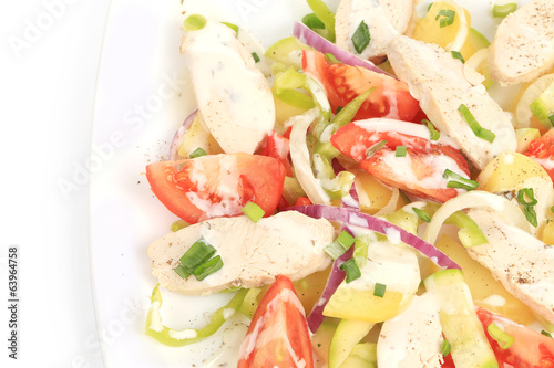 Chicken salad with potatoes.