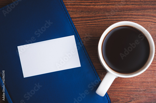 Notepad, calling card and coffee cup