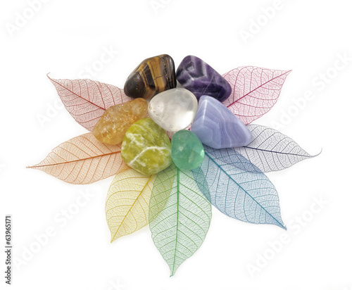 Foto op Canvas Edelsteen Healing Chakra Crystals on Leaves