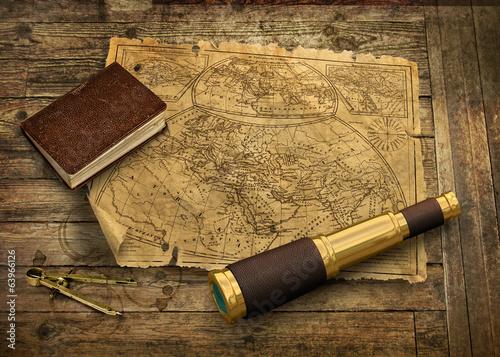 Leinwandbild Motiv Old world map with telescope