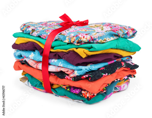stack of colored clothes on an isolated white background