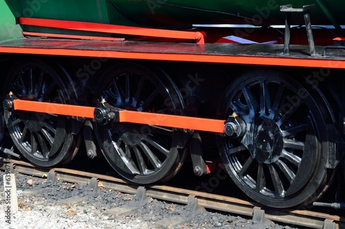 Three steam train wheels
