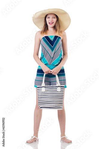 Pretty woman with summer handbag and panama isolated on white