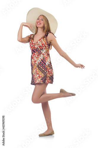 Beautiful dancing woman in summer dress isolated on white