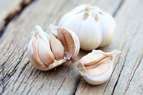 Organic garlic on wood background