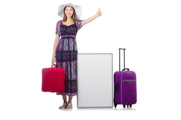 Woman in panama  preparing for vacation with suitcase and blankb