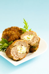 Meat roulade stuffed with cheese, egg and herbs