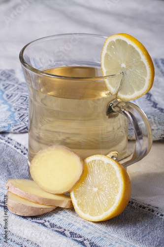 Ginger tea with lemon close up on the table. vertical